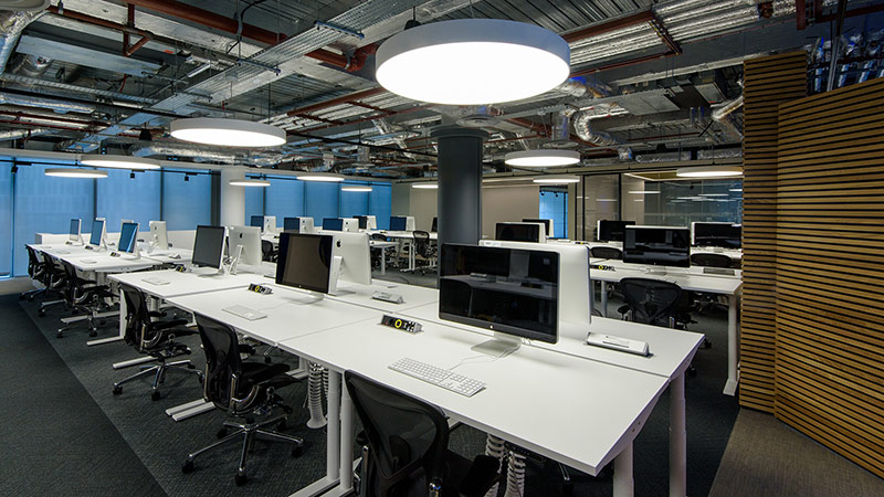 An office space with multiple computer stations setup.